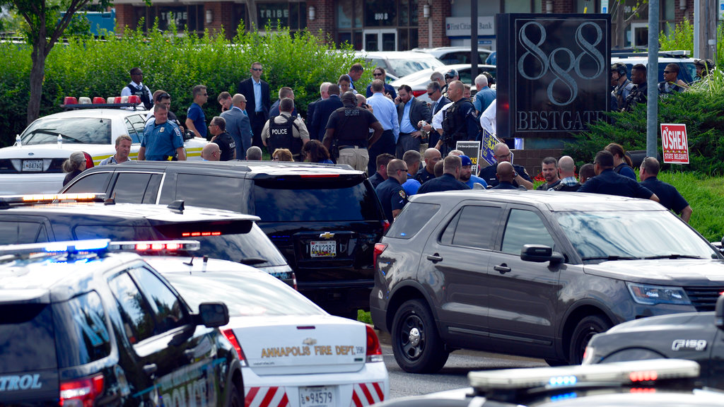 Police secure the scene of a shooting in Annapolis, Md., Thursday, June 28, 2018. (AP Photo/Susan Walsh)