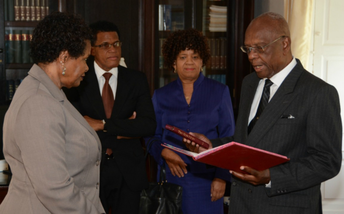 Temporary Senator, Delisle Bradshaw taking the oath of office before Governor General Dame Sandra Mason while Clerk of Parliament, Pedro Eastmond and Deputy Permanent Secretary, Cabinet Office, Harriette Sealy look on. (B.Hinds/BGIS)