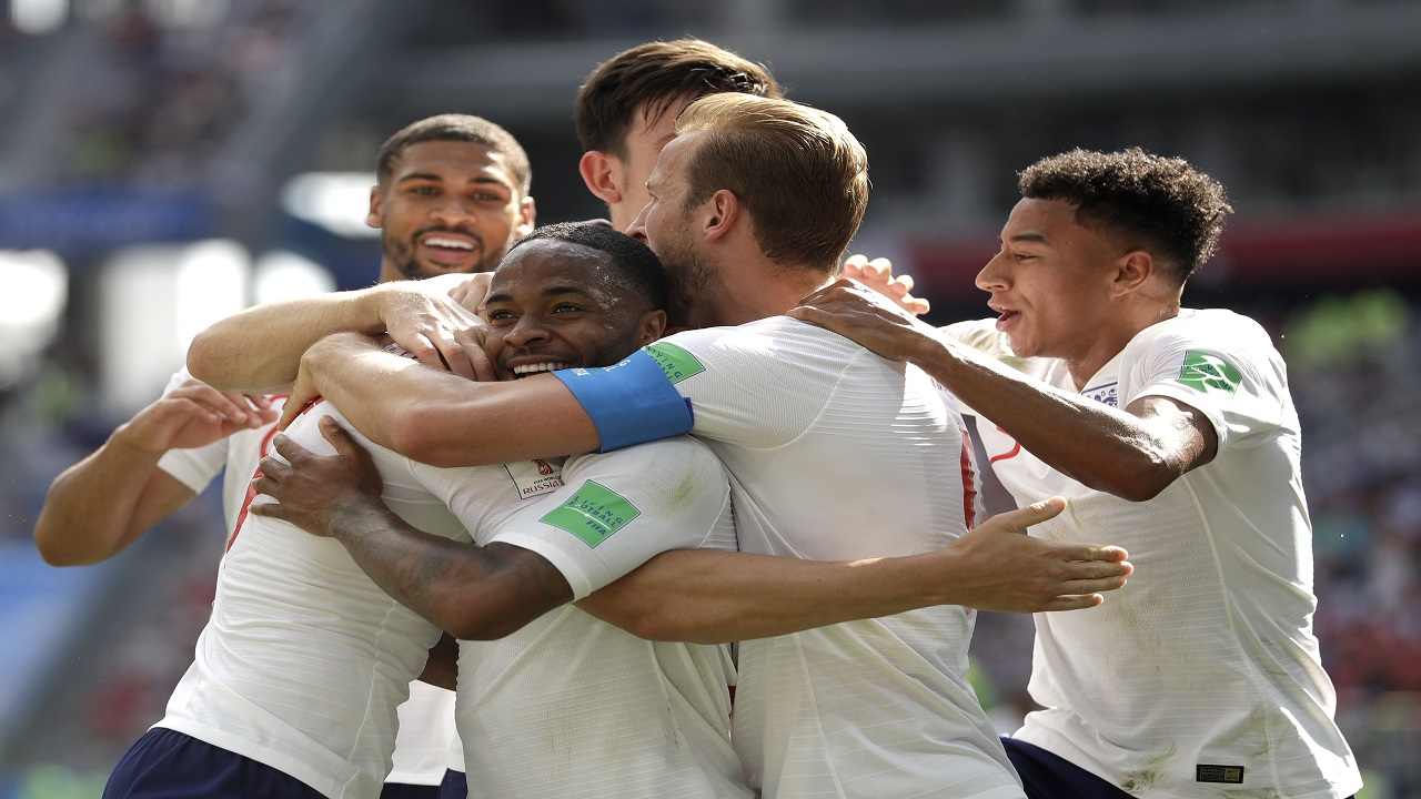 England players run to teammate John Stones after he scored his team's first goal during the group G match against Panama at the 2018 football World Cup at the Nizhny Novgorod Stadium in Nizhny Novgorod , Russia, Sunday, June 24, 2018. (AP Photo/Matthias Schrader).