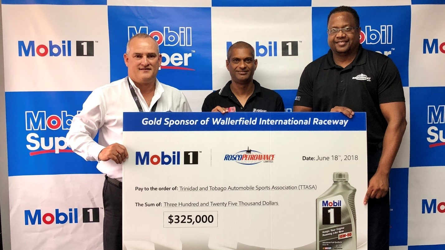 Standing from left to right: Mr. Wayne Bernard - CEO and Director, Rosco Petroavance Ltd., Mr. Jameer Ali - Vice President, Trinidad and Tobago Automobile Sports Association (TTASA) and Mr. Eugene Sylvester – Division Manager, Mobil Lubricants, Rosco Petroavance Ltd.