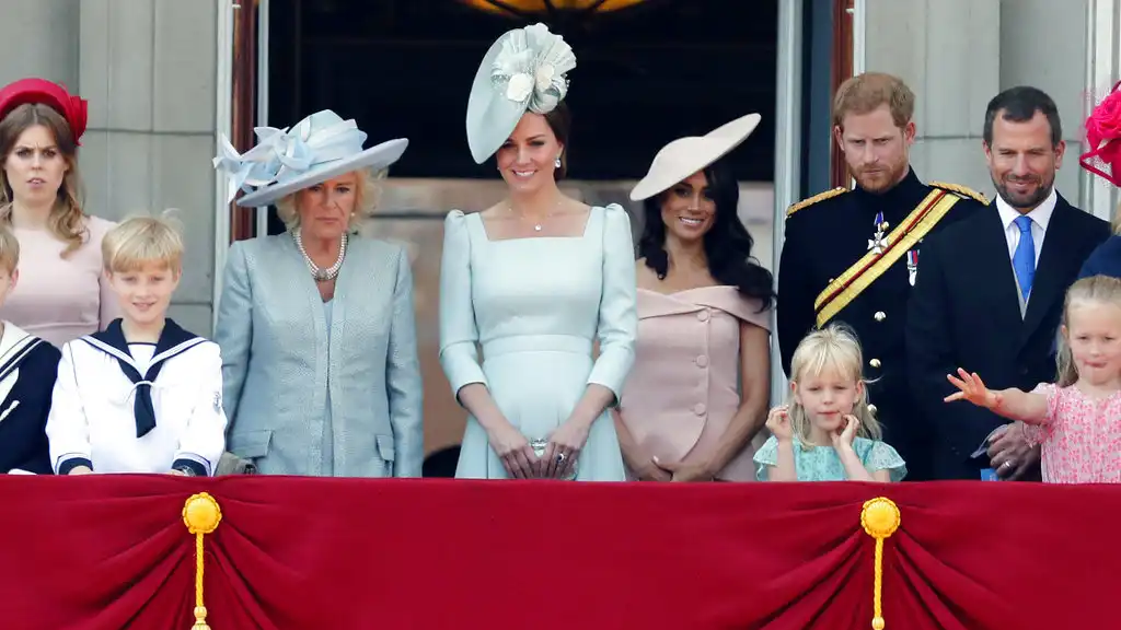 From left, Britain's Princess Beatrice, Camilla Duchess of Cornwall, Kate Duchess of Cambridge, Meghan Duchess of Sussex and Prince Harry attend the annual Trooping the Colour Ceremony in London, Saturday, June 9, 2018.(AP Photo/Frank Augstein)