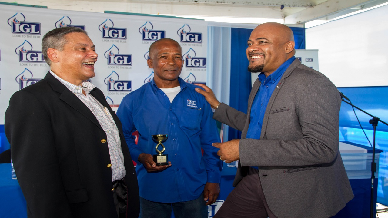 Wayne Kirkpatrick (left) General Manager of IGL, and Dwight Campbell (right) IGL's HS&E Manager, congratulate top prize winner Devon Campbell at IGL's Health, Safety & Environment (HS&E) Road Safety Award Programme last Wednesday. Devon Campbell, this year's big winner at the Awards Ceremony has been in the profession since 1982. But it was only after joining IGL in 2006 that he saw such an extensive dedication to both driver safety and journey management control systems.