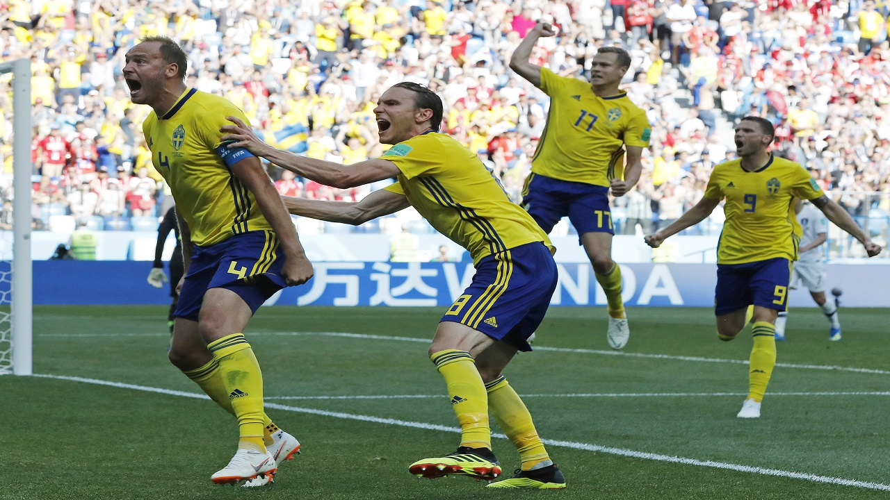 Sweden's Andreas Granqvist, left, celebrates after scoring the opening goal during the group F match between Sweden and South Korea at the 2018 soccer World Cup in the Nizhny Novgorod stadium in Nizhny Novgorod, Russia, Monday, June 18, 2018. (AP Photo/Pavel Golovkin)
