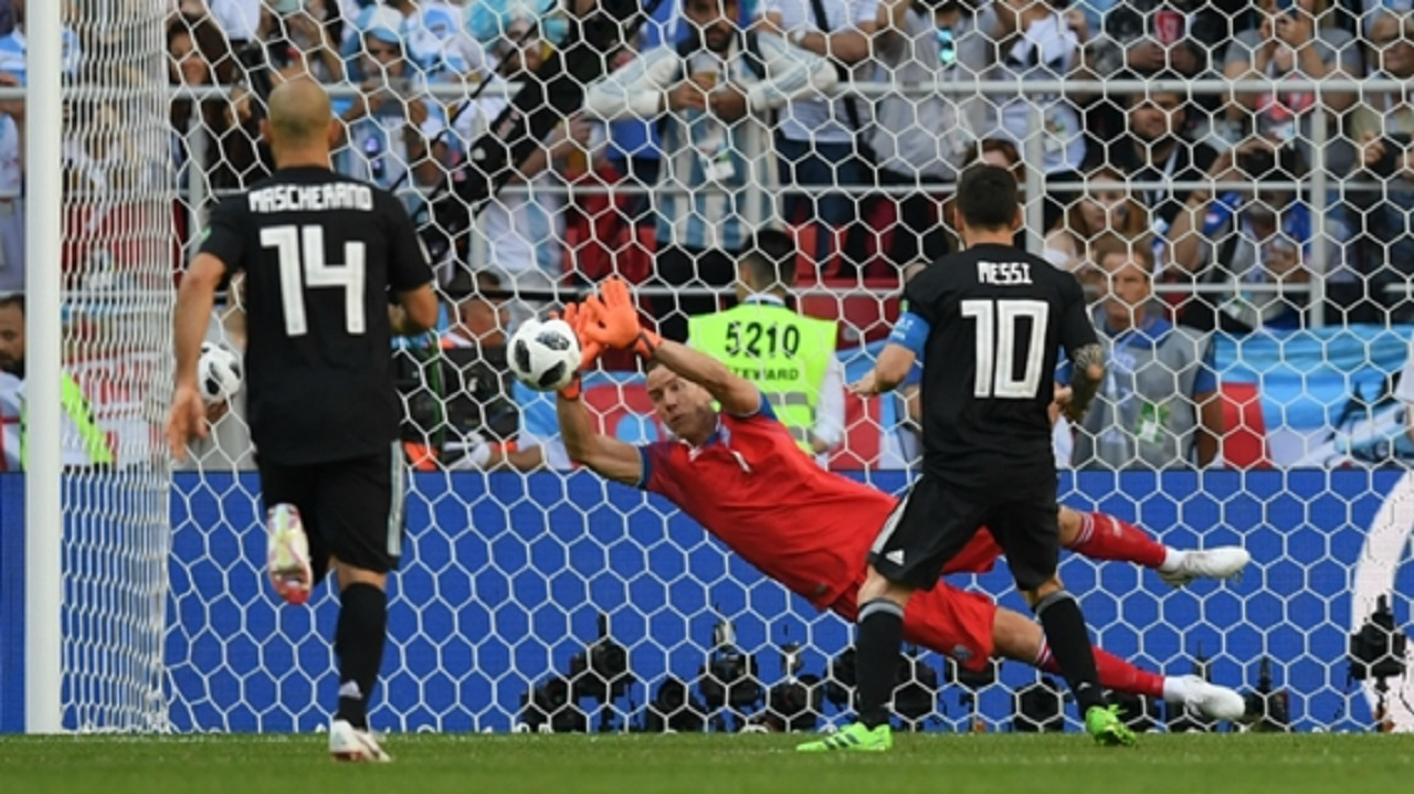 Lionel Messi sees his penalty saved against Iceland.