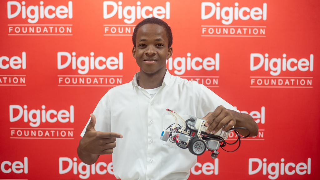 This student proudly displays a robot at the first National Tech Expo held at the Chaguanas South Secondary School on Friday June 1