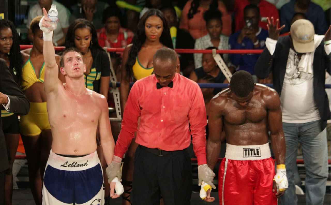 Canada's Dave Leblond (left) reacts after being announced winner of his first round fight against Jamaica's Toriano Nicholas.