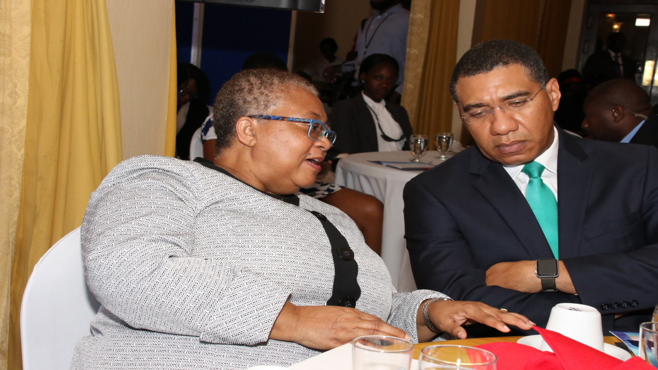 Managing Director of the Jamaica Stock Exchange (JSE) Marlene Street Forrest shares a word with Prime Minister Andrew Holness. (Photo: Llewellyn Wynter)