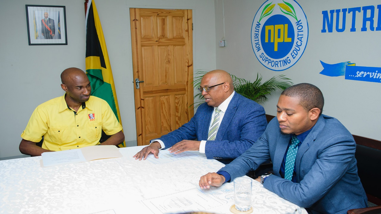 Restaurants of Jamaica Brand Manager Andrei Roper (left); Chairman of the Board of Nutrition Products Limited, Ewart Gilzean (centre), and State Minister for Education and Youth, Floyd Green (right)  discuss phase two of ROJ's Add Hope programme, set to kick off in September of this year.