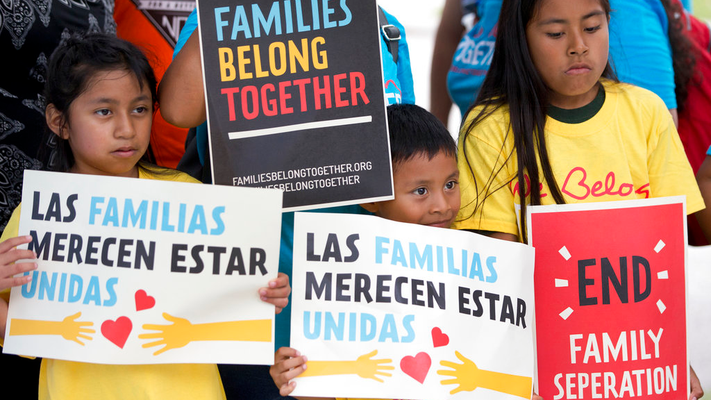 In this June 1 photo, children hold signs during a demonstration in front of the Immigration and Customs Enforcement offices in Miramar, Fla. The Trump administration's move to separate immigrant parents from their children on the U.S.-Mexico border has turned into a full-blown crisis in recent weeks, drawing denunciation from the United Nations, Roman Catholic bishops and countless humanitarian groups. (AP Photo/Wilfredo Lee, File)