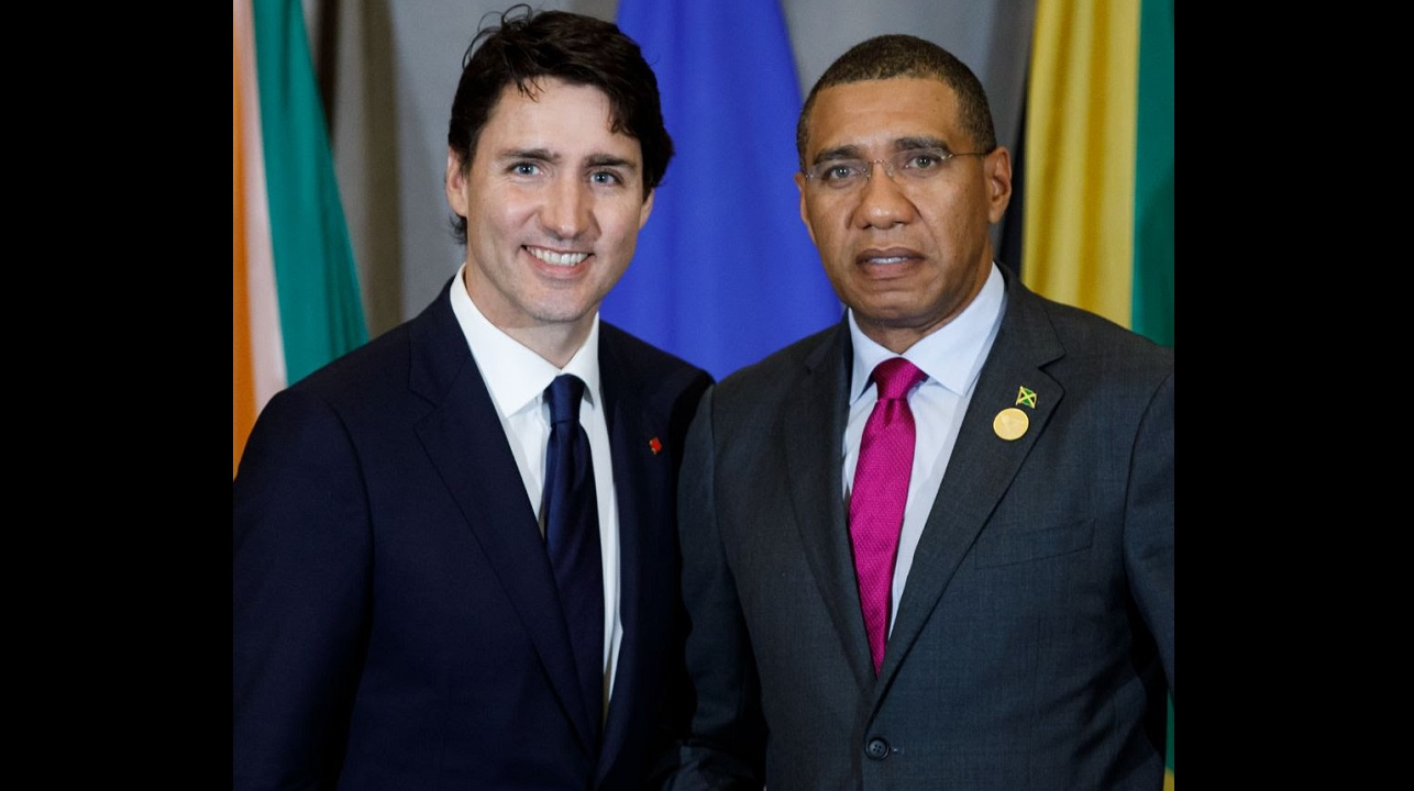 Andrew Holness (right), with Canadian Prime Minister Justin Trudeau. (PHOTO: OPM)