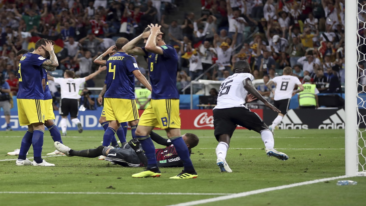 Sweden players reacts after Germany's Toni Kroos, right, scores his side's second goal during the group F match  at the 2018 football World Cup in the Fisht Stadium in Sochi, Russia, Saturday, June 23, 2018. (AP Photo/Thanassis Stavrakis).