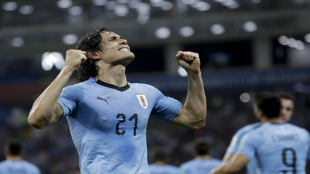 Uruguay's Edinson Cavani celebrates after scoring his side's 2nd goal during the round of 16 match against Portugal at the 2018 football World Cup at the Fisht Stadium in Sochi, Russia, Saturday, June 30, 2018. (AP Photo/Andre Penner).