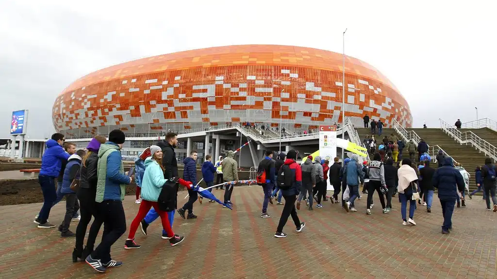 In this photo taken on Saturday, April 21, 2018 walk to the new World Cup stadium to watch the Russian second league soccer match between Mordovia and Zenit-Izhevsk in Saransk, Russia. (AP Photo/Julia Chestnova)