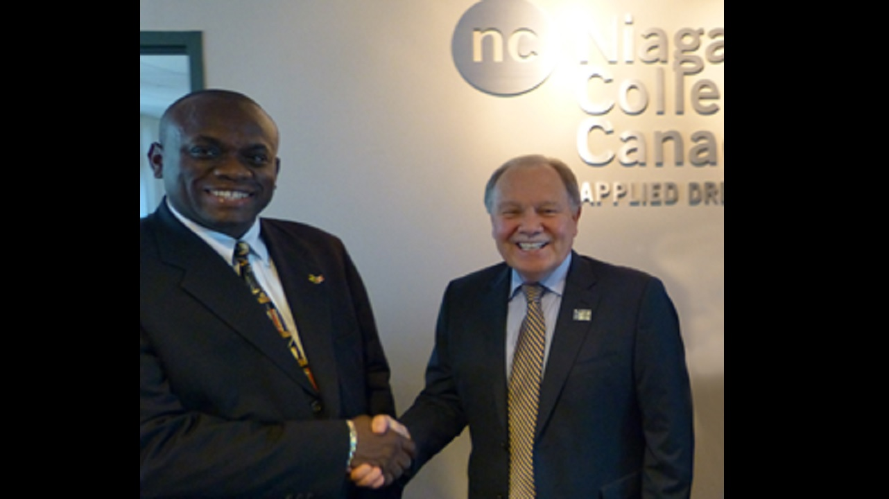 Philmore McCarthy, principal of Excelsior Community College shakes hand with Dr Dan Patterson, president of Niagara College.