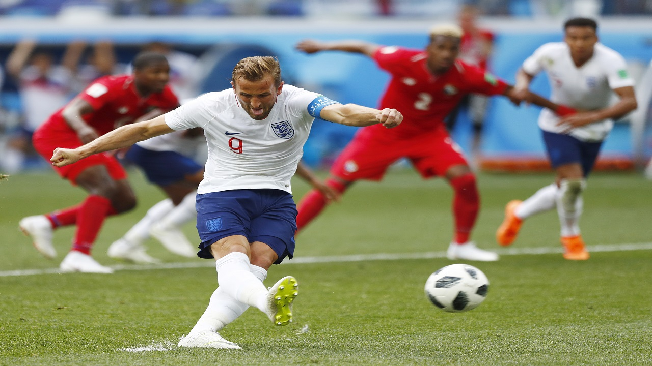 England's Harry Kane kicks a penalty to score his team's second goal during the group G match against Panama at the 2018 football World Cup at the Nizhny Novgorod Stadium in Nizhny Novgorod , Russia, Sunday, June 24, 2018. (AP Photo/Matthias Schrader).