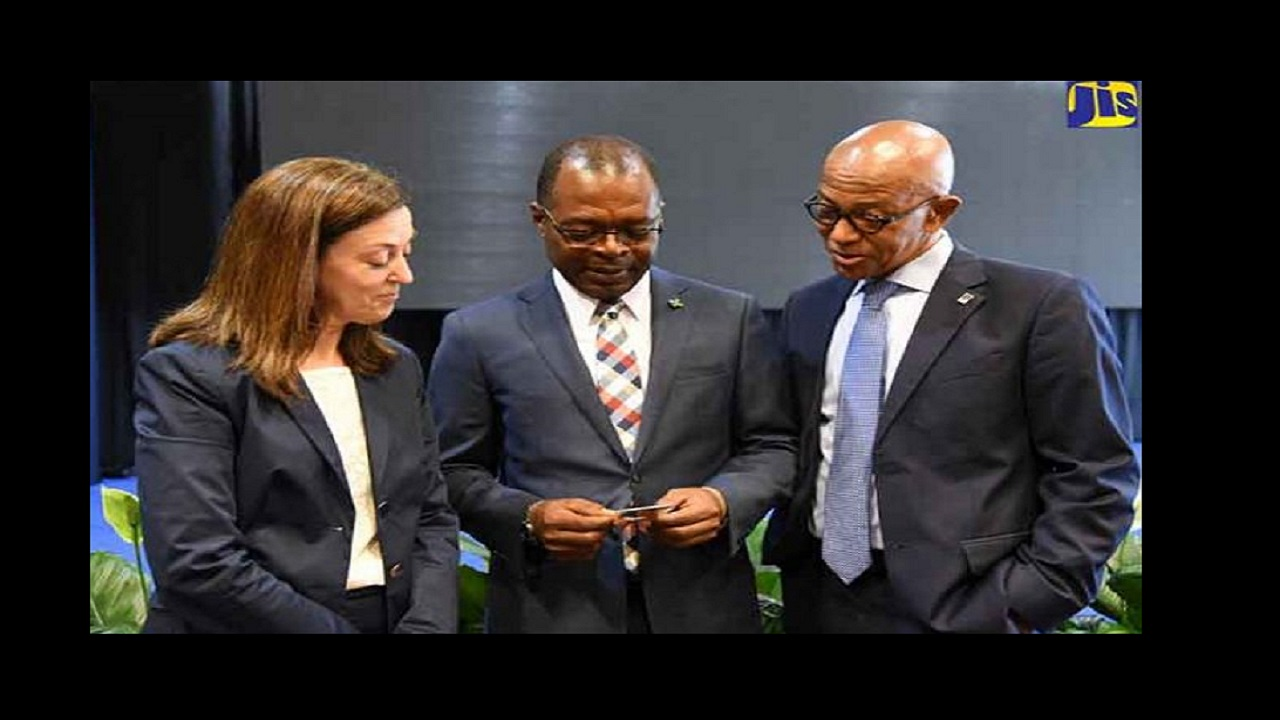 Deputy Governor at the Bank of Jamaica (BOJ), Livingston Morrison (centre), engages with Senior Consultant at the World Bank, Miren Aparicio (left); and Managing Director of the Development Bank of Jamaica (DBJ), Milverton Reynolds, at the opening of Jamaica's first Electronics Retail Payments conference. Photo: JIS