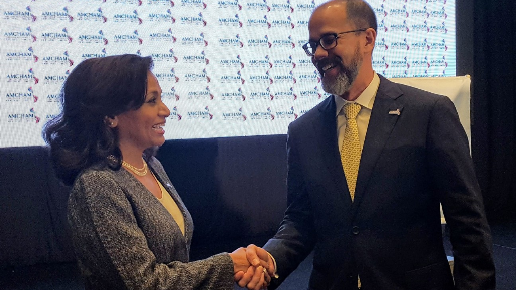Newly elected AMCHAM T&T President Patricia Ghany (left) shares a light moment with outgoing President, Mitchell De Silva (right).