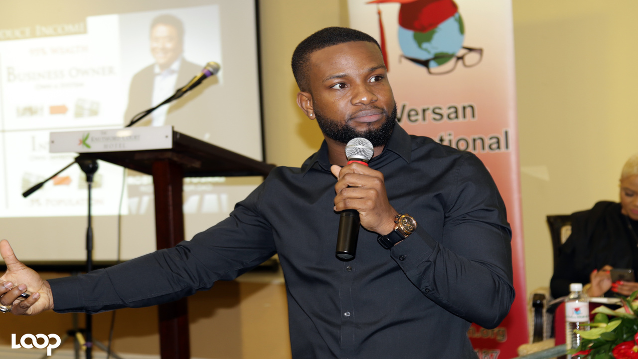 Network marketer Joel Worrell speaks at the Keep Growing Young Professionals Conference at the Knutsford Court Hotel last Saturday. (PHOTOS: Ramon Lindsay)