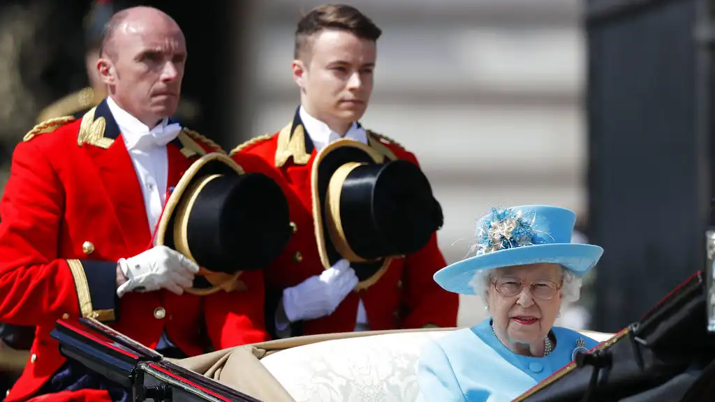 Britain's Queen Elizabeth rides in a carriage to attend the annual Trooping the Colour Ceremony in London, Saturday, June 9, 2018.(AP Photo/Frank Augstein)