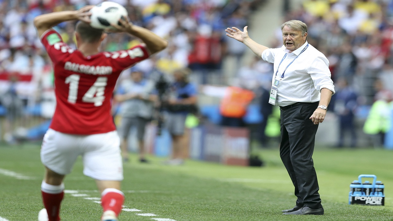 In this file photo from June 26, 2018, Denmark coach Age Hareide, right, gestures during the Group C match against France at the 2018 World Cup at the Luzhniki Stadium in Moscow, (AP Photo/David Vincent, File).