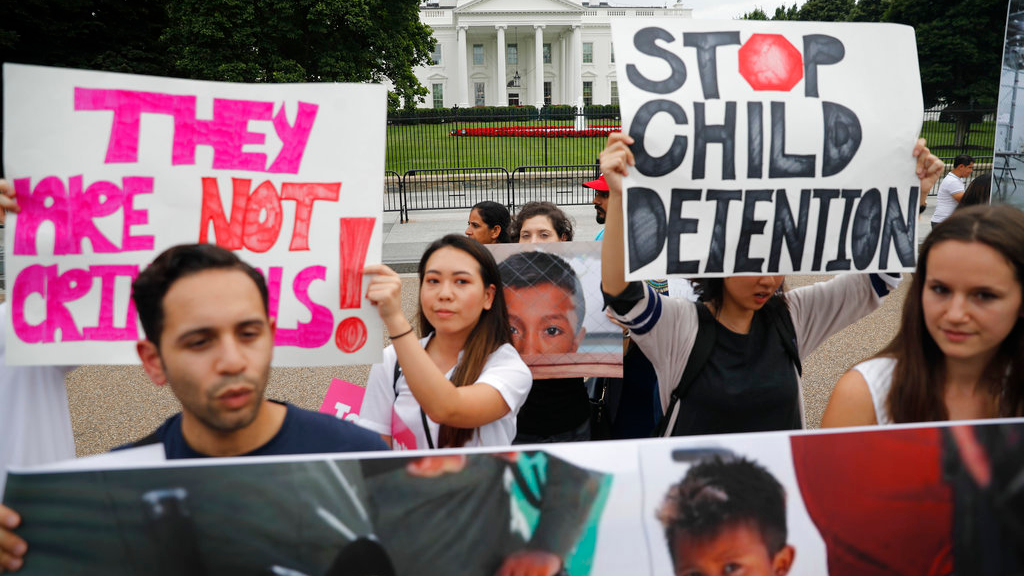 People hold up signs and photographs during a demonstration opposed to the White House policy that separated more than 2,300 children from their parents over the past several weeks in front of the White House in Washington, Thursday, June 21, 2018. (AP Photo/Pablo Martinez Monsivais)