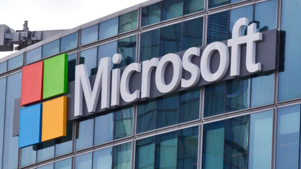 "This April 12, 2016 file photo shows the Microsoft logo in Issy-les-Moulineaux, outside Paris, France. The cyberextortion attack hitting dozens of countries was a ""perfect storm"" of sorts. It combined a known and highly dangerous security hole in Microsoft Windows, tardy users who didn't apply Microsoft's March software fix, and a software design that allowed the malware to spread quickly once inside university, business and government networks. (AP Photo/Michel Euler, File)"