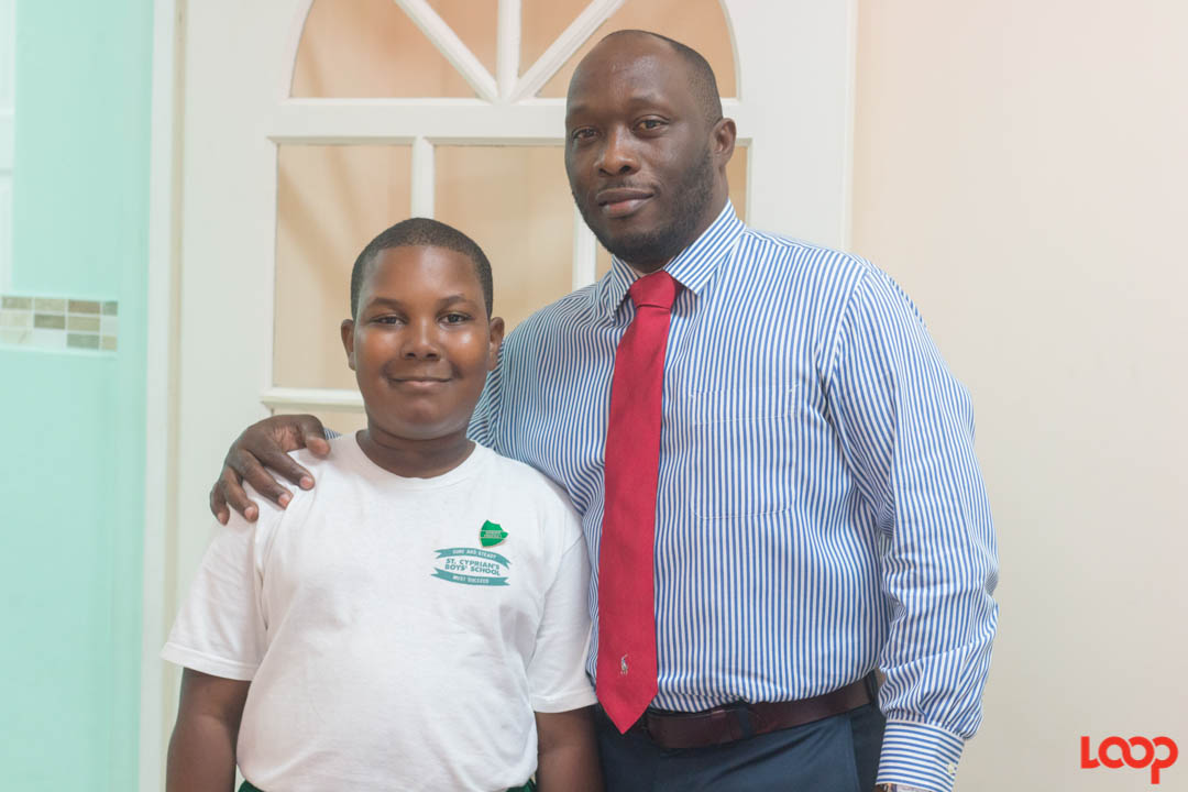 Top performer in the island, Neil Charles with Principal Dave Layne.