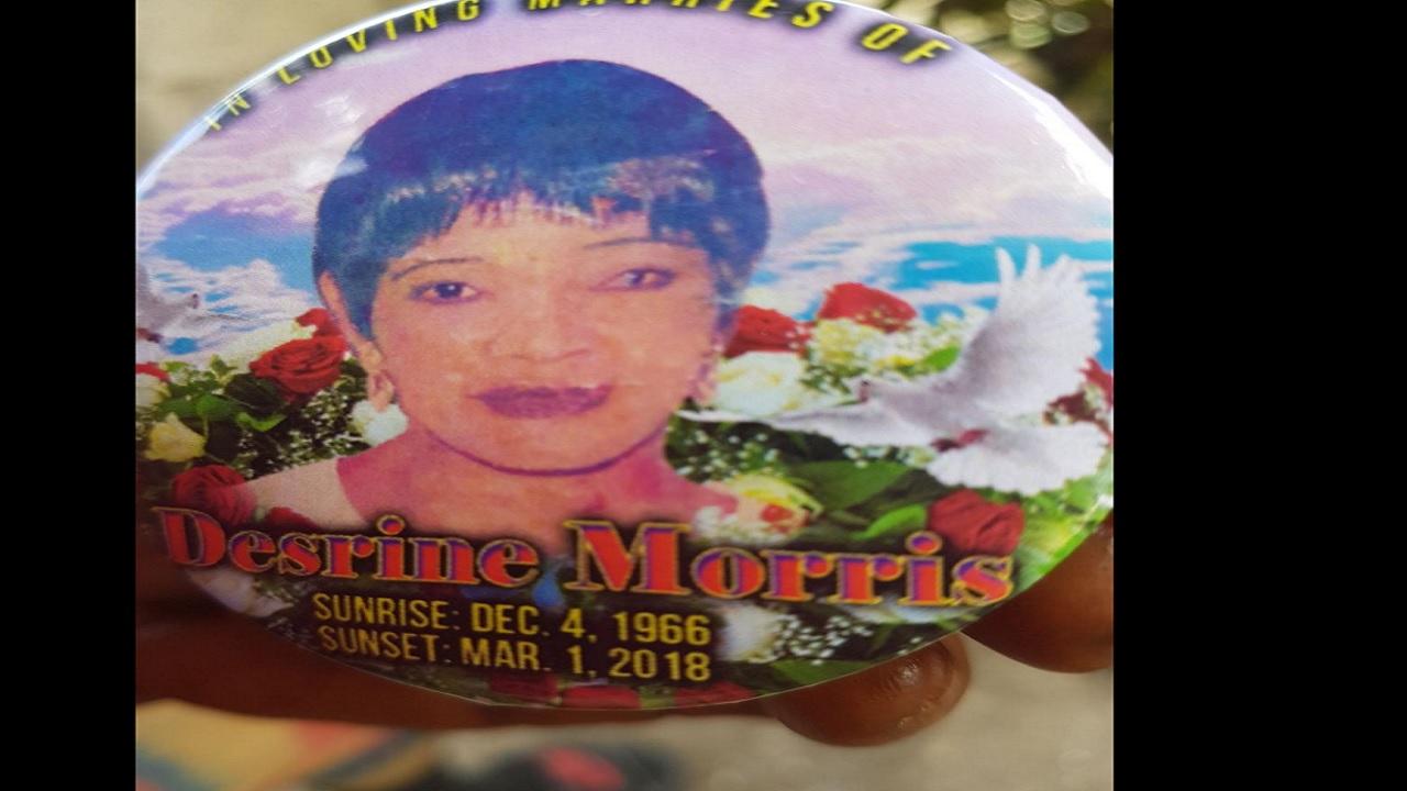 A funeral button for Desreen Morris