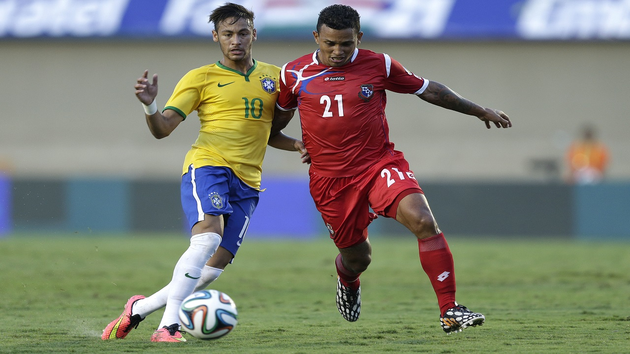 In this June 3, 2014 file photo, Brazil's Neymar, left, fights for the ball with Panama's Amilcar Henriquez during a friendly football match at the Serra Dourada stadium in Goiania, Brazil. Henriquez was murdered in April 2017. (AP Photo/Andre Penner, File)