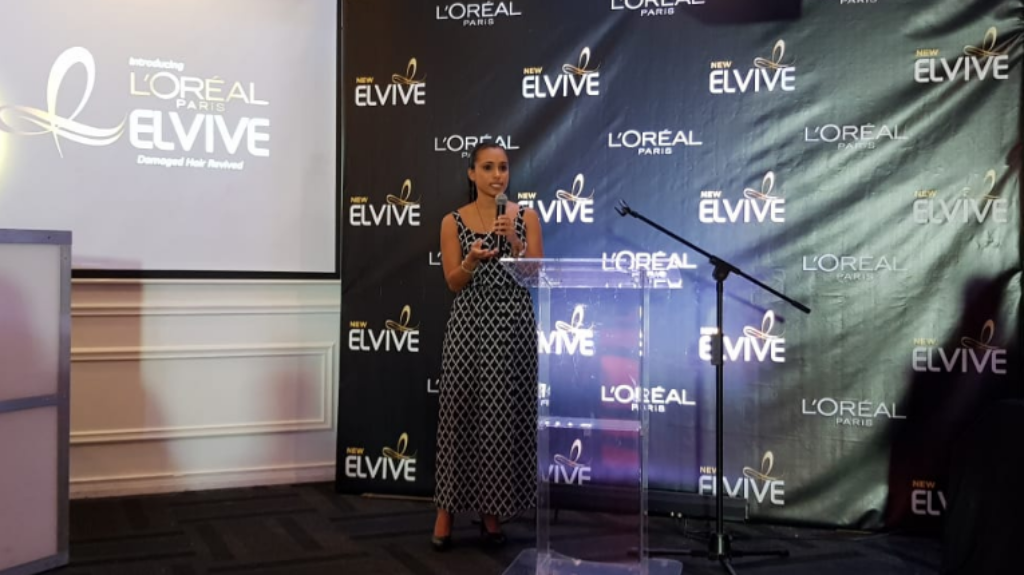 Brand Manager for L'Oreal Danielle Tardieu addresses the crowd at the launch of the L'Oreal Elvive line at Vas Lounge on May 24, 2018