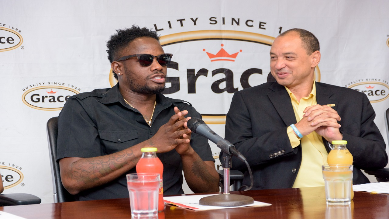 :(L-R) Grace Foods newest Global Brand Ambassador Kemar 'Ding Dong' Ottey gets candid with CEO of Grace Kennedy, Don Wehby.
