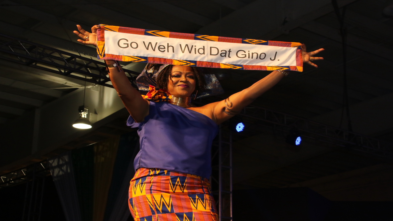 "Dr Verene Shepherd sported African wear, and launched here protest on stage with a banner bearing the words ""Guh whe wid dat Gino J"" to an amused audience."