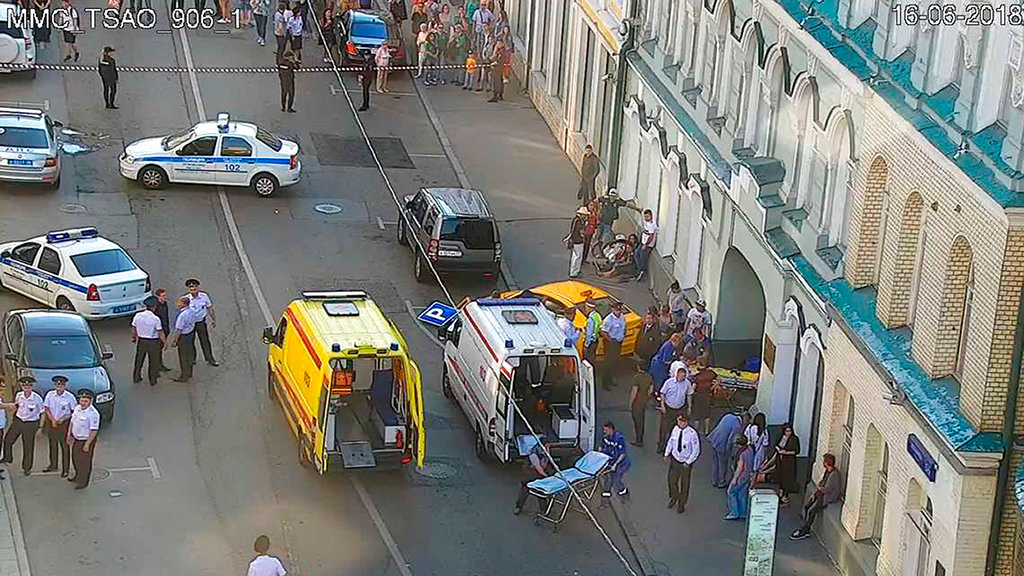 In this image provided by Moscow Traffic Control Center Press Service, ambulance and police work at the site of an incident after a taxi crashed into pedestrians on a sidewalk near Red Square in Moscow, Russia, Saturday, June 16, 2018. Police in Moscow say at least seven people have been injured when a taxi crashed into pedestrians on a sidewalk near Red Square. (Moscow Traffic Control Center Press Service via AP)