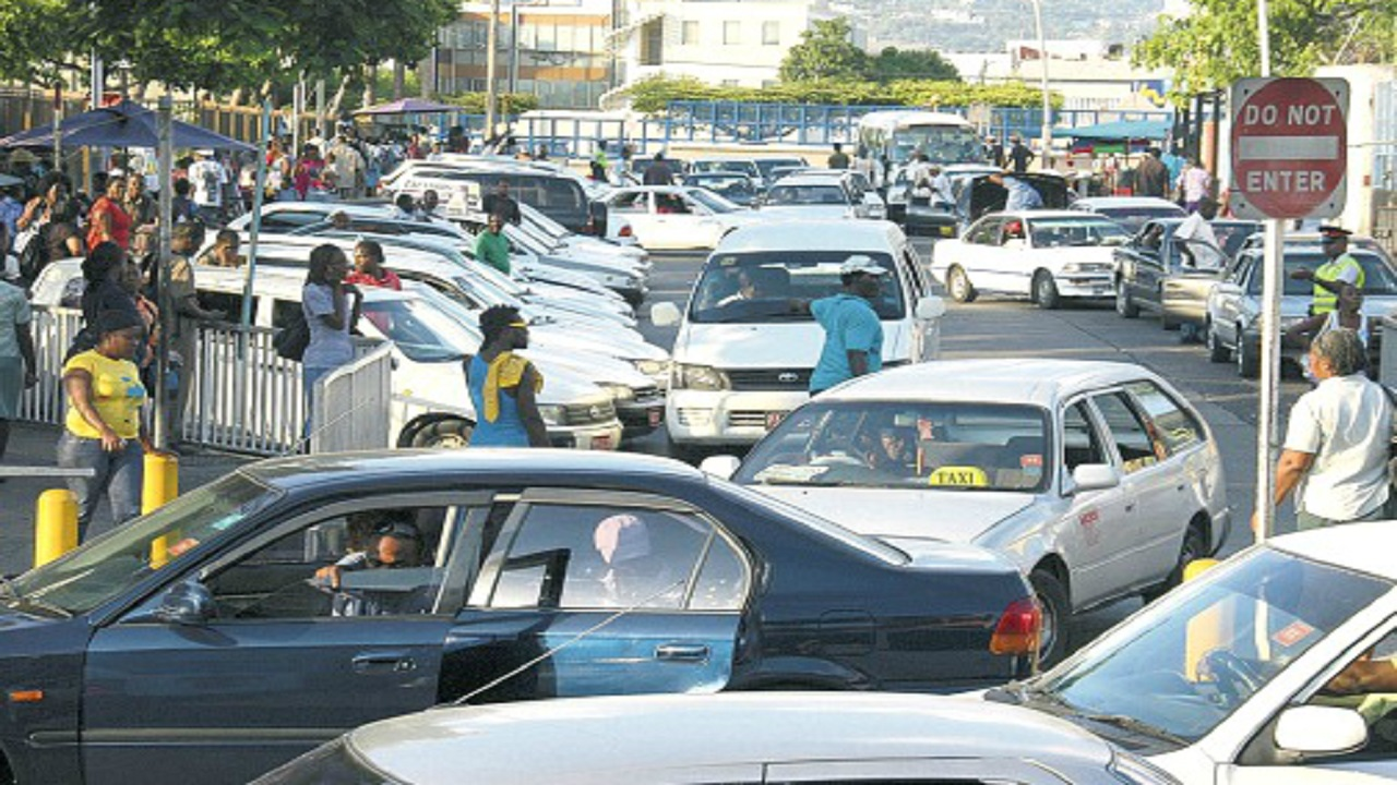 File photo of a taxi stand in the Corporate Area. Extortionists regularly prey on taxi and bus operators.