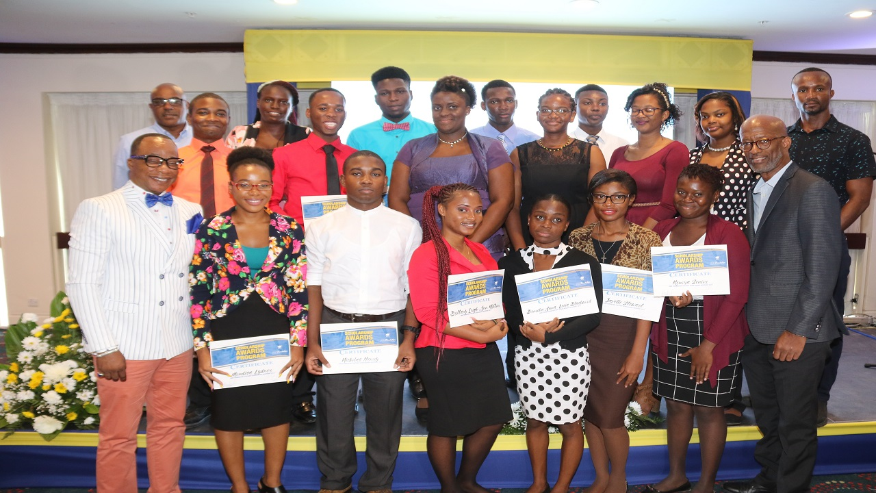 Chairman of J. Wray and Nephew and the JWN Foundation, Clement 'Jimmy' Lawrence (front row, right), shares a moment with tertiary scholarship recipients and members of the judging panel during the 2017 JWN Scholarship Awards ceremony.
