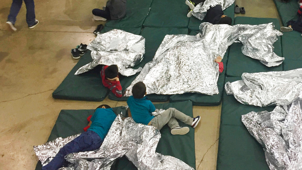 In this Sunday, June 17, 2018 photo provided by U.S. Customs and Border Protection, people who have been taken into custody related to cases of illegal entry into the United States, rest in one of the cages at a facility in McAllen, Texas. (U.S. Customs and Border Protection's Rio Grande Valley Sector via AP, File)