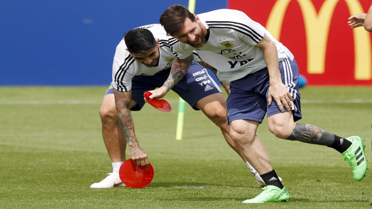 Lionel Messi collects field marks during a training session of Argentina at the 2018 soccer World Cup in Bronnitsy, Russia, Sunday, June 24, 2018. (AP Photo/Ricardo Mazalan)
