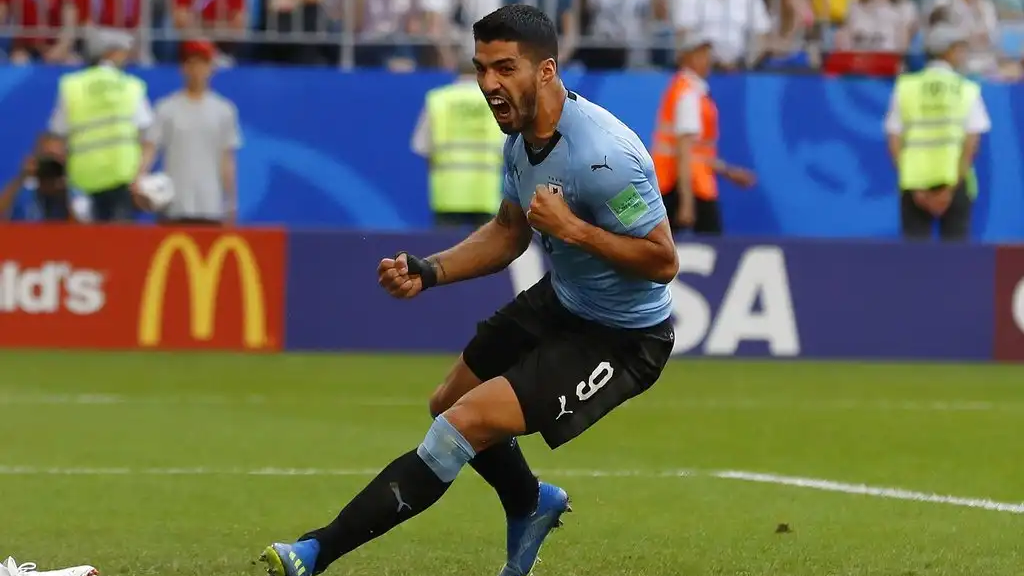 Uruguay's Luis Suarez celebrates the second goal of his team during the group A match between Uruguay and Russia at the 2018 World Cup at the Samara Arena in Samara, Russia, Monday, June 25, 2018. (AP Photo/Rebecca Blackwell)