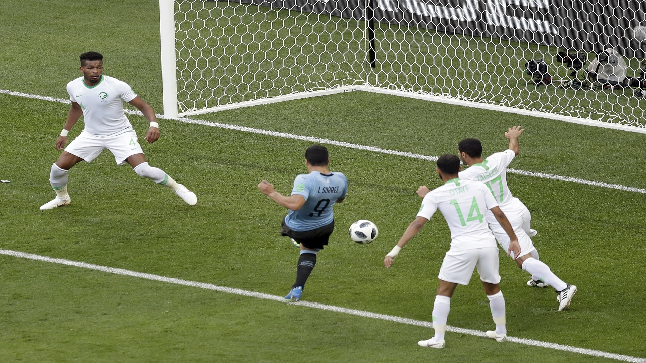 Uruguay's Luis Suarez, center, scores during the group A match against Saudi Arabia at the 2018 football World Cup in Rostov Arena in Rostov-on-Don, Russia, Wednesday, June 20, 2018. (AP Photo/Themba Hadebe).