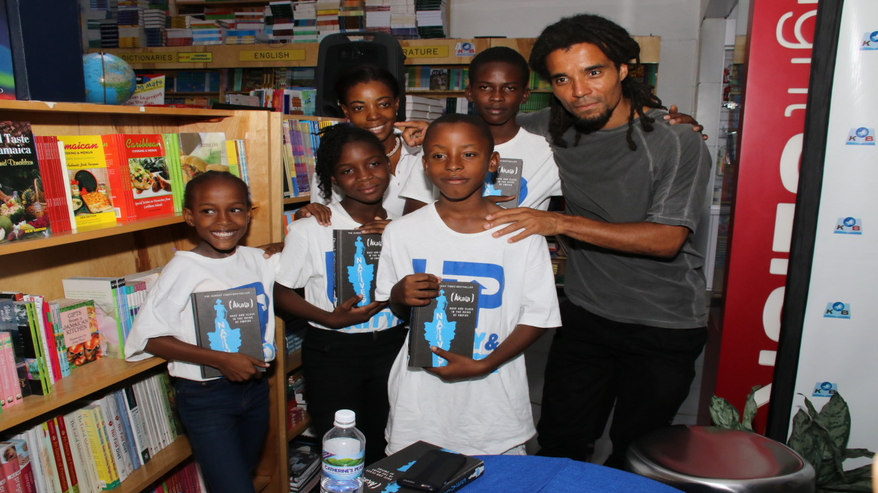 Akala with several young readers at his book reading at the Post Mall in Liguanea, St Andrew. (PHOTOS: Llewellyn Wynter)