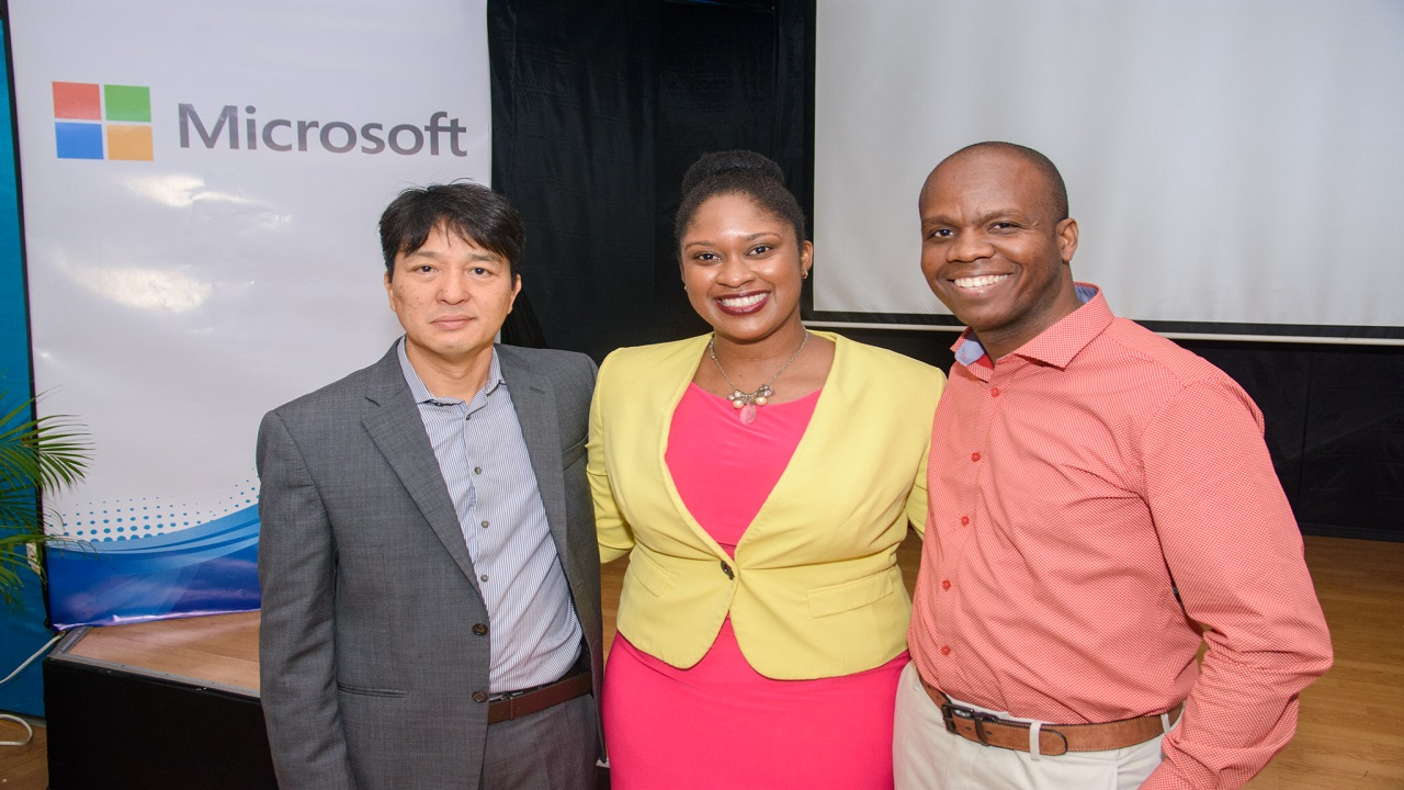 From Left: Mauro Miyake, Commercial Partner Lead, Laycya Holmes, Jamaica Country Representative for Microsoft, and Almando Cox, Director of Discount Computer Supplies pose together after a successful launch.