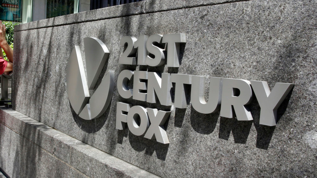 FILE - This Aug. 1, 2017, file photo shows the Twenty-First Century Fox sign outside of the News Corporation headquarters building in New York. (AP Photo/Richard Drew, File)