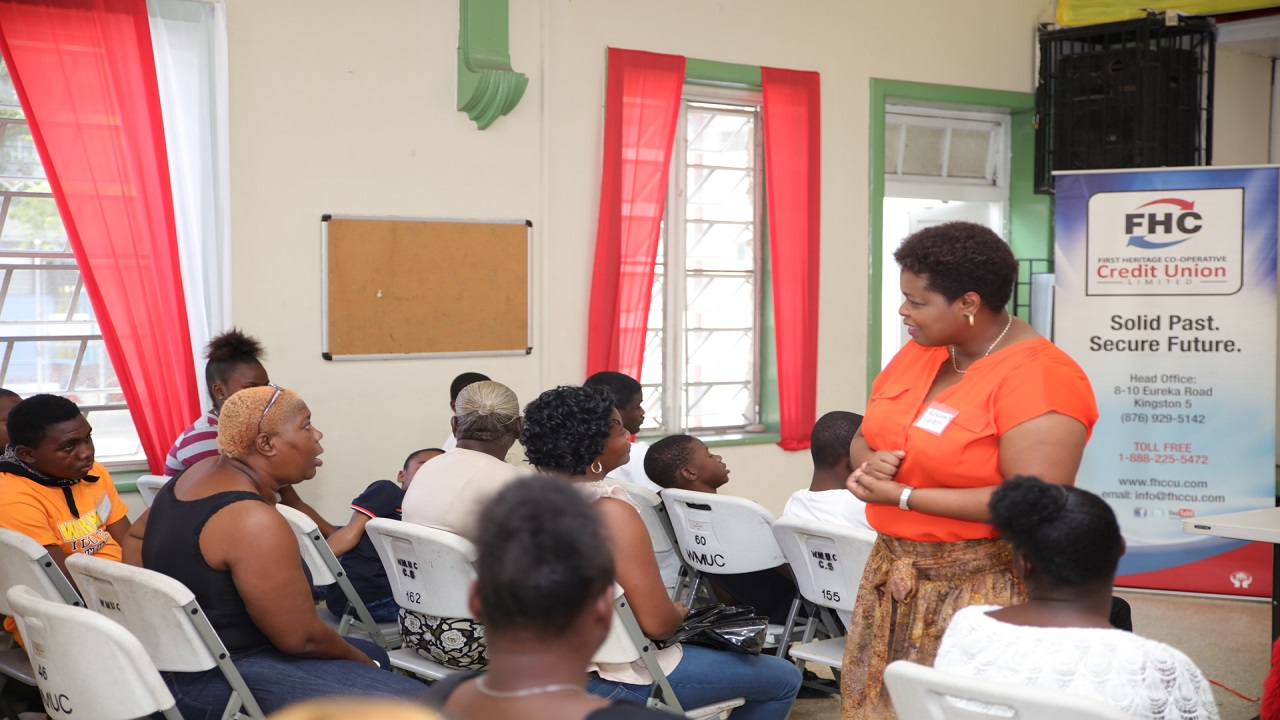 Roxan Linton, CEO, First Heritage Co-operative Credit Union speaks directly with Phyllis Shand, parent participant of The Re-Birth Project about the importance of budgeting during her presentation on Financial Literacy and Entrepreneurship at The Re-Birth Project's recently held session.