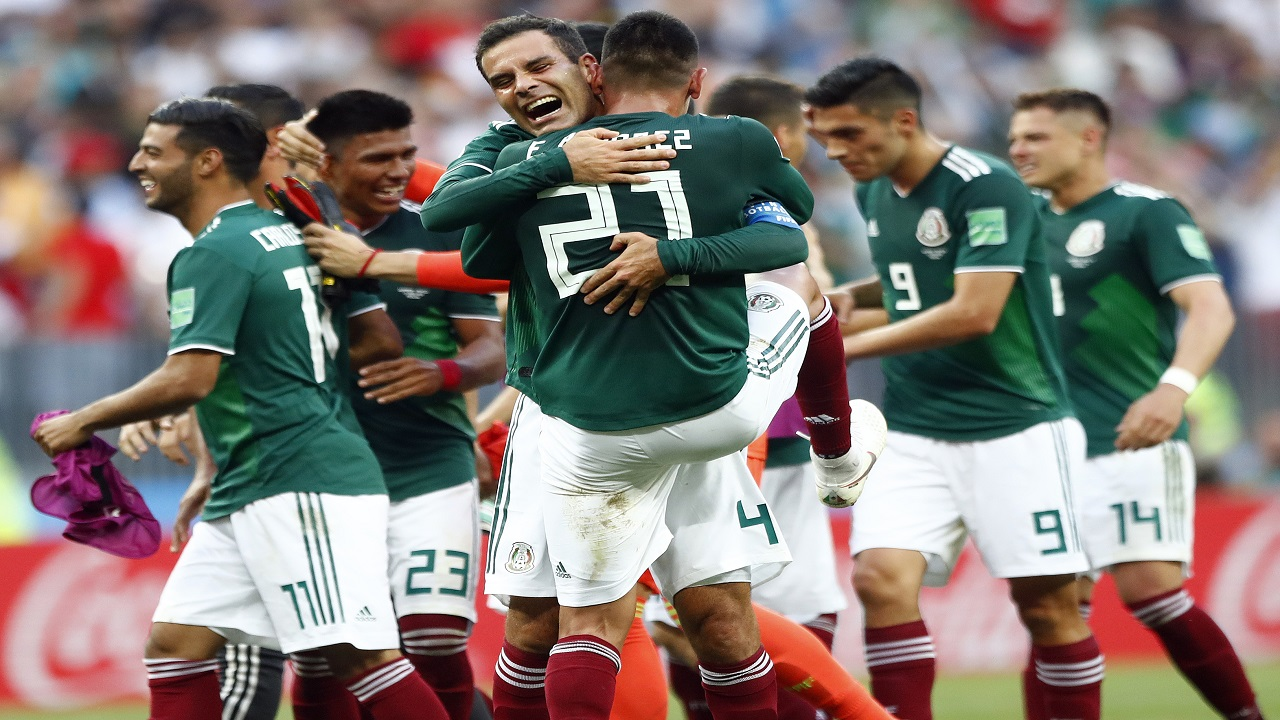 Mexico players celebrate after winning the group F match against Germany at the 2018 football World Cup in the Luzhniki Stadium in Moscow, Russia, Sunday, June 17, 2018. Mexico won 1-0. (AP Photo/Matthias Schrader).
