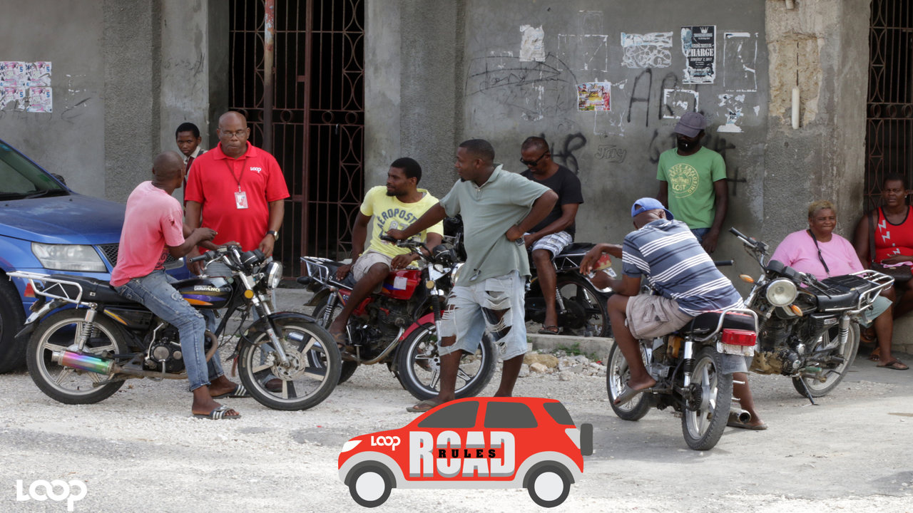 Loop News' Reginald Allen engages a group of motorcyclists in discussion in Little London, Westmoreland. (PHOTO & VIDEO: Ramon Lindsay)