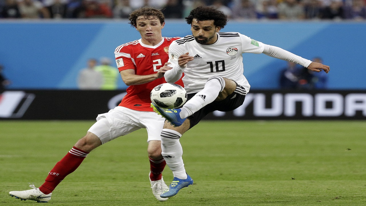 Russia's Mario Fernandes, left, challenges for the ball Egypt's Mohamed Salah, right, during the group A match at the 2018 footbalal World Cup in the St. Petersburg stadium in St. Petersburg, Russia, Tuesday, June 19, 2018. (AP Photo/Gregorio Borgia)