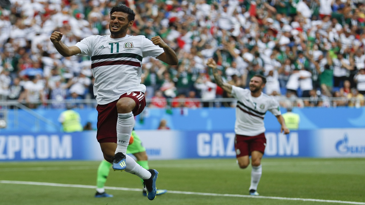 Mexico's Carlos Vela celebrates after scoring the opening goal during the group F match against South Korea at the 2018 football World Cup in the Rostov Arena in Rostov-on-Don, Russia, Saturday, June 23, 2018. (AP Photo/Eduardo Verdugo).