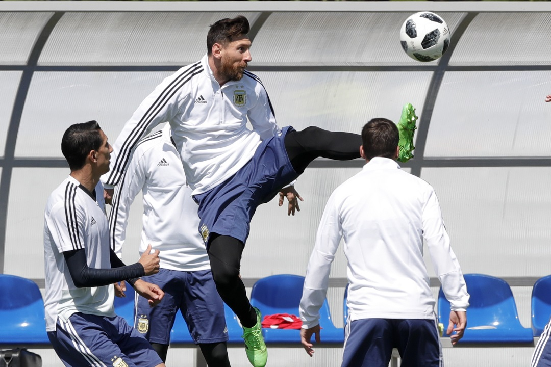 Lionel Messi plays the ball during a training session of Argentina on the eve of the group D match against Iceland at the 2018 football World Cup in Bronnitsy, Russia, Friday, June 15, 2018.