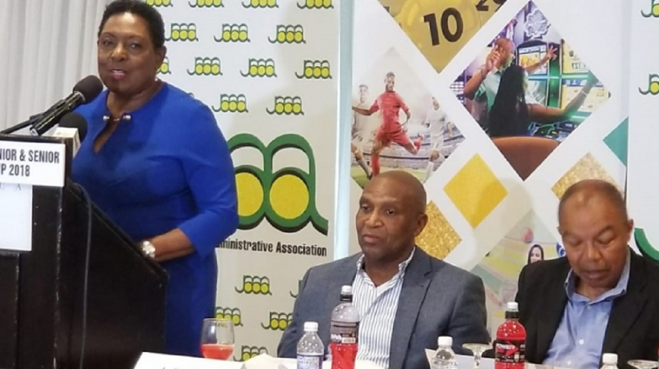 Sports Minister Olivia Grange (left) makes her presentation during the launch of the 2018 JAAA/Supreme Ventures National Junior and Senior Athletics Championships on Tuesday at the Jamaica Pegasus Hotel.