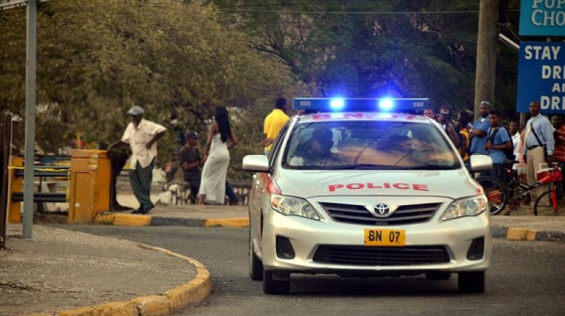 File photo of a police patrol car on the outskirts of Cassava Piece in St Andrew after a violent incident in the community.